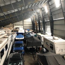 cars, boats, generators being parked in a storage space